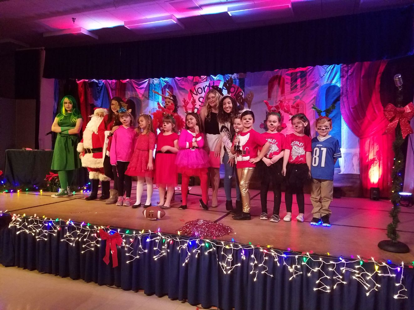 The cast of Rosefield's North Pole Star are met with a round of applause as they gather for their group photo.