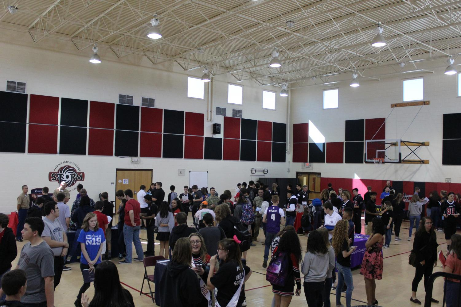 Students gather around in the gym to learn more information about colleges and the armed forces.
