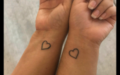 Junior Karissa Jimenez and her mother share matching heart tattoos on their wrists.