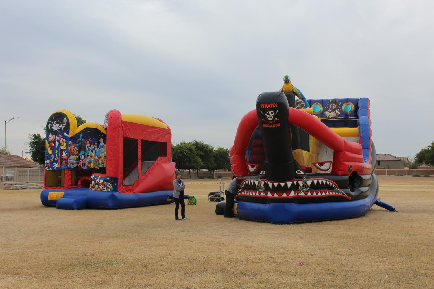 Two large bounce houses were there for kids to jump on.