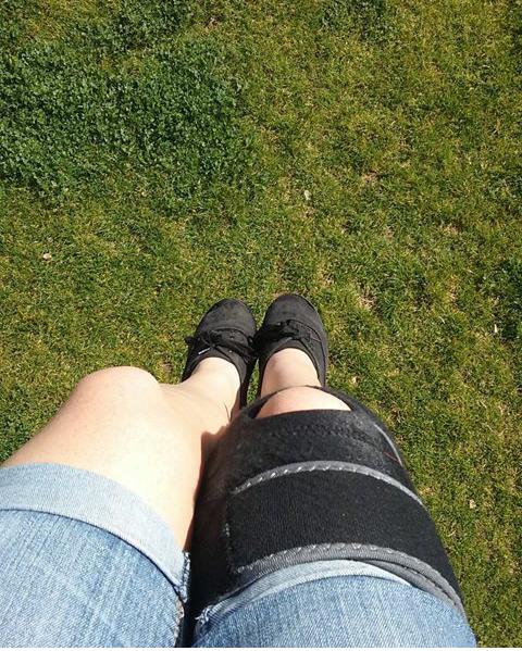 Chilling at the park, wearing my trusty knee brace.