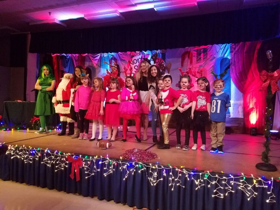The cast of Rosefields North Pole Star are met with a round of applause as they gather for their group photo.