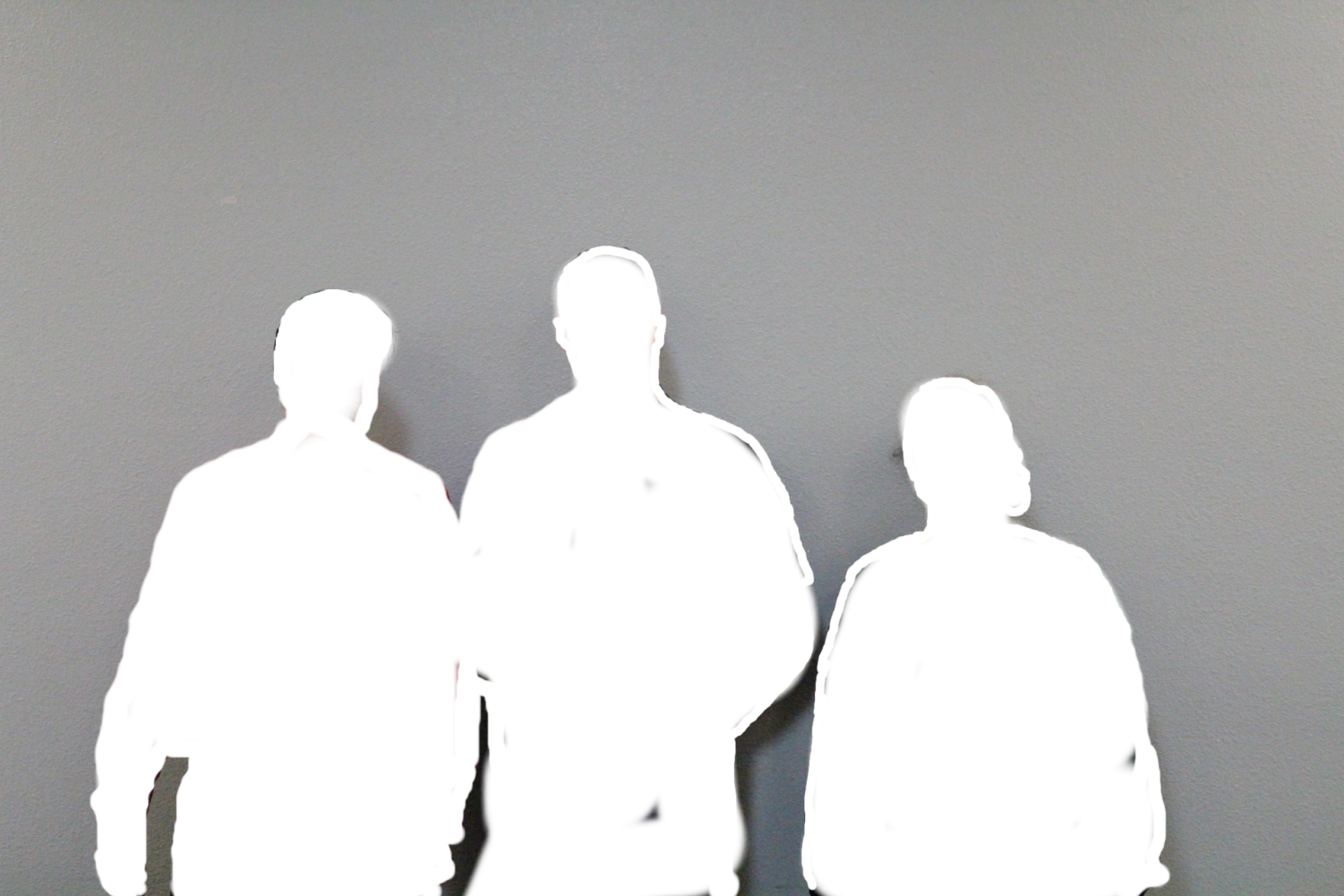 Our three mystery teachers got together for a photo op, but somehow our camera only detected the outline of their bodies.