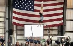 This is Isabella Pilon at a competition, doing a handstand on the uneven-bars.