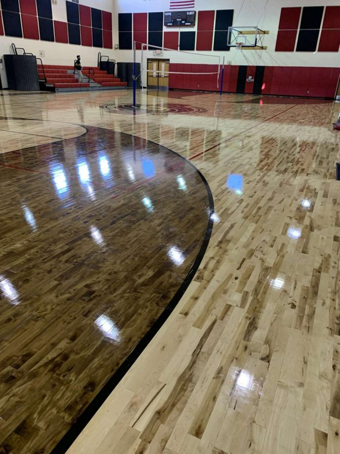 Out with the old, in with the new gym floor