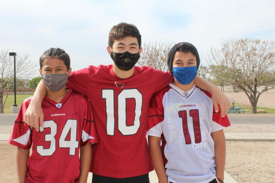 (L to R) Seventh graders Simeon Johnson, Zander Myers and Matias Pedraza dressed in Cardinals football jerseys for