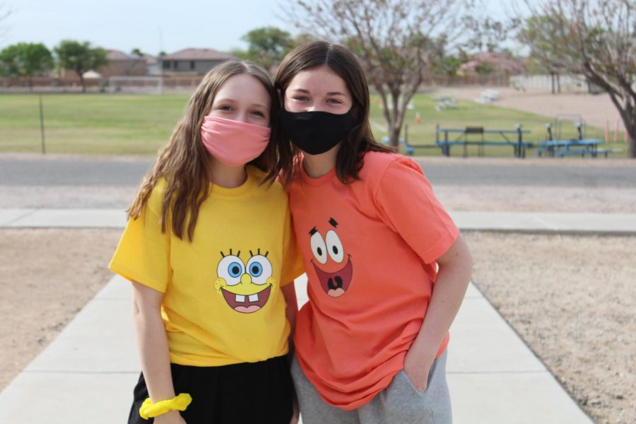 (L to R) Seventh graders Addison Hood and Baylea McCabe dressed in Spongbob Squarepants and Patrick Star shirts for