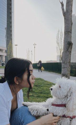 Vittoria Rho, an exchange student from Milan, Italy and her dog, Muffin.
